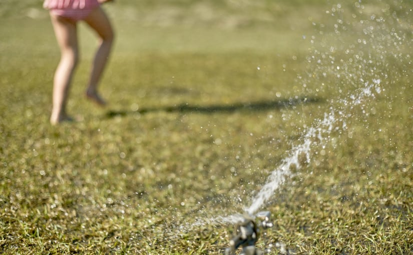 Watering your lawn helps keep it healthy and green.